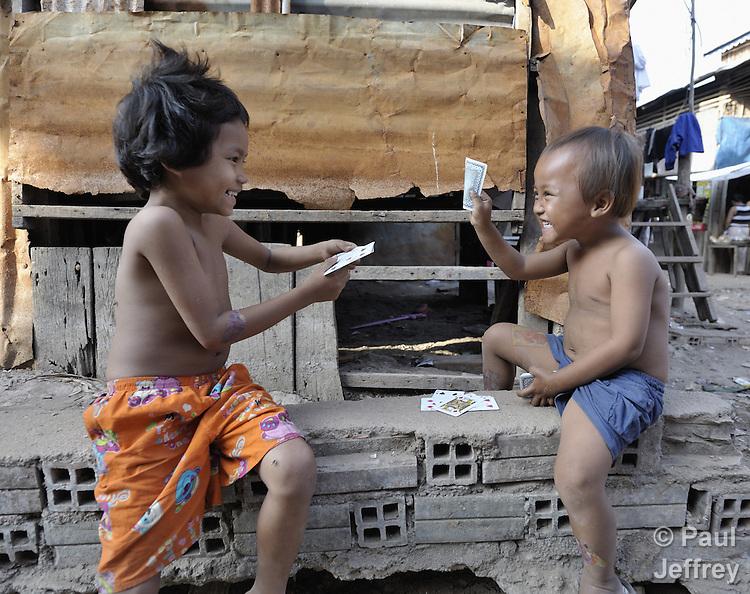 Boys playing cards in the Chamroen neighborhood of Phnom Penh, Cambodia.