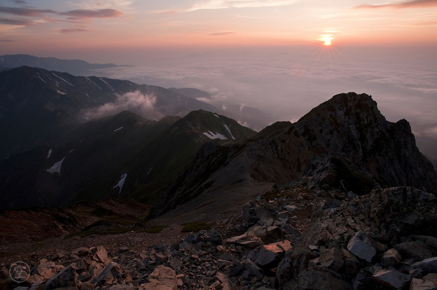 Sunrise over clouds below the summit of Mount Goryu in Japan's North Alps. Nagano, Japan.