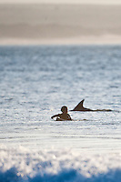 PAT CURREN (USA) son of former world surfing champion Tom Curren surfing with dolphins at Jeffreys Bay, (Saturday 11th July 2009), Eastern Cape, South Africa ,   Photo: joliphotos.com