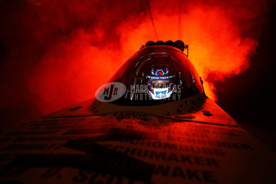 Jan 12, 2018; Brownsburg, IN, USA; NHRA top fuel driver Antron Brown poses for a portrait during a photo shoot at Don Schumacher Racing. Mandatory Credit: Mark J. Rebilas-USA TODAY Sports