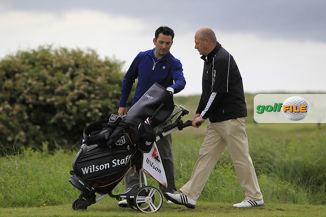 Gary O'Flaherty (Cork) on the 10th with his caddie Michael (Drogheda) during Round 3 of the East of Ireland in the Co. Louth Golf Club at Baltray on Monday 2nd June 2014.<br /> Picture:  Thos Caffrey / www.golffile.ie