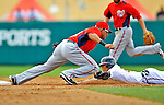 6 March 2012: Washington Nationals infielder Ian Desmond gets a sliding Andrelton Simmons out at second during a Spring Training game against the Atlanta Braves at Champion Park in Disney's Wide World of Sports Complex, Orlando, Florida. The Nationals defeated the Braves 5-2 in Grapefruit League action. Mandatory Credit: Ed Wolfstein Photo