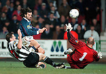 Dunfermline v Rangers 13.12.97: Marco Negri chips the ball over goalkeeper Ian Westwater