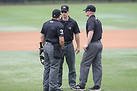 Bowie, MD - May 6, 2018: The umpires meet to discuss a call during the MiLB game between Akron and Bowie at  Baysox Stadium in Bowie, MD.  (Photo by Elliott Brown/Media Images International)