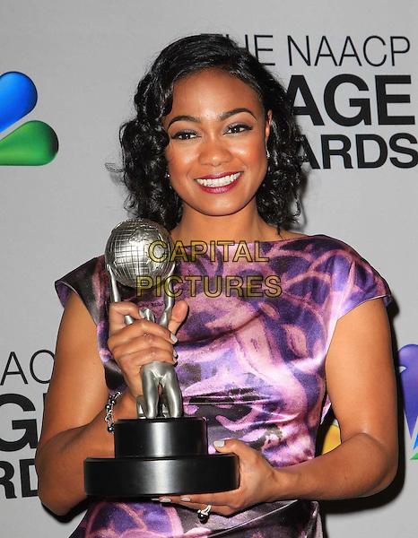 Tatyana Ali.44th NAACP Image Awards - Press Room Held At The Shrine Auditorium, Los Angeles, California, USA, .1st February 2013..half length purple print dress award winner trophy .CAP/ADM/KB.©Kevan Brooks/AdMedia/Capital Pictures.