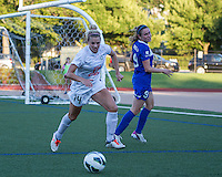 In a National Women's Soccer League Elite (NWSL) match, the Boston Breakers defeated the FC Kansas City, 1-0, at Dilboy Stadium on August 10, 2013.  FC Kansas City defender Lauren Sesselmann (14) wins the ball from attacking Boston Breakers midfielder Heather O'Reilly (9) near the Kansas City goals.