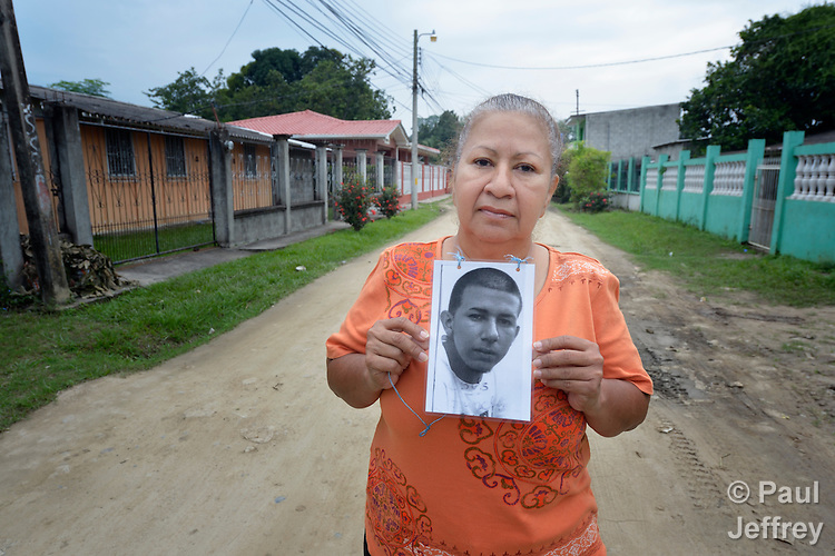 Vilma Maldonado holds a photo of her son Jesus Humberto Sanchez Maldonado in the street near her home in La Lima, Honduras. The young man left for the United States in 2010, but Maldonado hasn't heard from him since his last phone call home in 2011 from the northern Mexican city of Monterrey. Maldonado is a member of a group of mothers of migrants who have disappeared on their journey north.