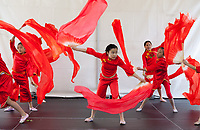 Girls performing Chinese Red Fan Fire Dance, Northwest Folklife Festival 2016, Seattle Center, Washington, USA.