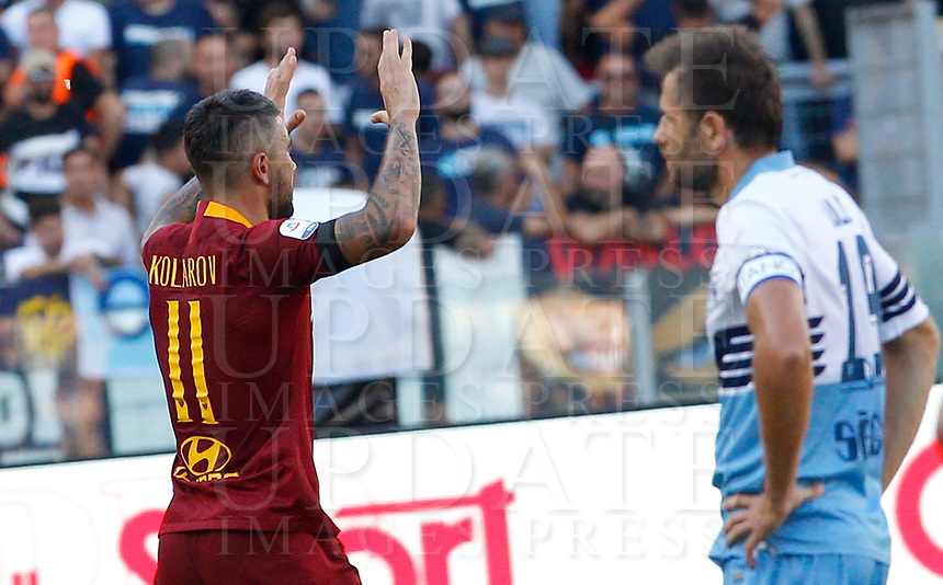Roma's Aleksandar Kolarov, left, celebrates after scoring as Lazio's Senad Lulic reacts during the Italian Serie A football match between Roma and Lazio at Rome's Olympic stadium, September 29, 2018. Roma won 3-1.<br /> UPDATE IMAGES PRESS/Riccardo De Luca