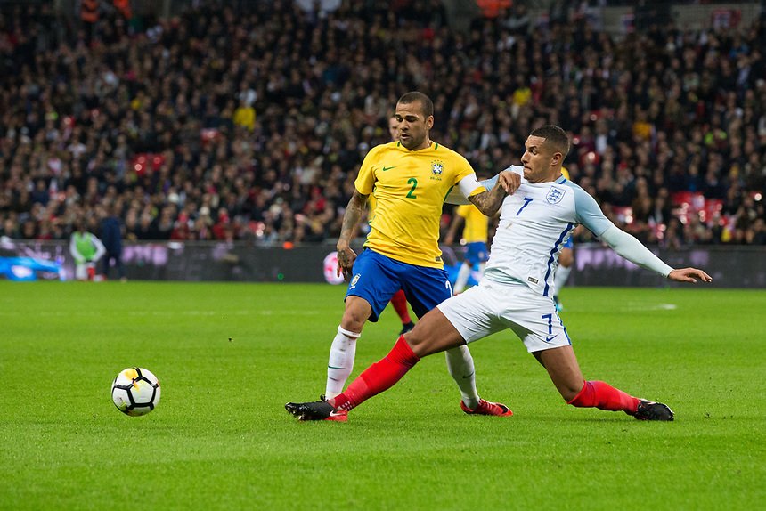 Brazil&rsquo;s Dani Alves is tackled by England's Jake Livermore <br /> <br /> Photographer Craig Mercer/CameraSport<br /> <br /> The Bobby Moore Fund International - England v Brazil - Tuesday 14th November 2017 Wembley Stadium - London  <br /> <br /> World Copyright &copy; 2017 CameraSport. All rights reserved. 43 Linden Ave. Countesthorpe. Leicester. England. LE8 5PG - Tel: +44 (0) 116 277 4147 - admin@camerasport.com - www.camerasport.com
