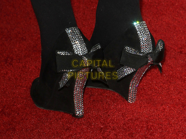 "Carly Williams' shoes.AFI Fest 2011  Premiere Of ""Carnage"" Held At Grauman's Chinese Theatre, Hollywood, California, USA..November 5th, 2011.feet heels detail black silver bows ribbons wedges.CAP/ADM/KB.©Kevan Brooks/AdMedia/Capital Pictures."