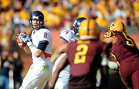 Nov. 28, 2009; Tempe, AZ, USA; Arizona Wildcats quarterback (8) Nick Foles looks for a receiver in the second quarter against the Arizona State Sun Devils at Sun Devil Stadium. Mandatory Credit: Mark J. Rebilas-