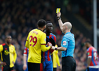7th March 2020; Selhurst Park, London, England; English Premier League Football, Crystal Palace versus Watford; Referee Anthony Taylor giving a yellow card to Cheikhou Kouyate of Crystal Palace