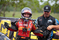 Apr 13, 2019; Baytown, TX, USA; NHRA top fuel driver Brittany Force with crew member during qualifying for the Springnationals at Houston Raceway Park. Mandatory Credit: Mark J. Rebilas-USA TODAY Sports