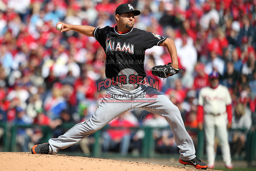 Miami Marlins pitcher Edward Mujica #34 delivers a pitch during a game against the Philadelphia Phillies at Citizens Bank Park on April 9, 2012 in Philadelphia, Pennsylvania.  Miami defeated Philadelphia 6-2.  (Mike Janes/Four Seam Images)