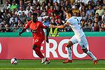 10.08.2019, Donaustadion, Ulm, GER, DFB Pokal, SSV Ulm 1846 Fussball vs 1. FC Heidenheim, <br /> DFL REGULATIONS PROHIBIT ANY USE OF PHOTOGRAPHS AS IMAGE SEQUENCES AND/OR QUASI-VIDEO, <br /> im Bild Merveille Biankadi (Heidenheim, #23), Florian Krebs (Ulm, #4)<br /> <br /> Foto © nordphoto / Hafner