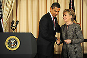Washington, DC - January 22, 2009 -- United States President Barack Obama shakes hands with his Secretary of State Hillary Clinton smile after an event where they announced the appointment of two new envoys to the Middle East, India and Pakistan, at the State Department  in Washington, DC, USA on 22 January 2009. Former Senator George Mitchell will serve as envoy to the Middle East and former Ambassador Richard Holbrook will serve Pakistan and India..Credit: Matthew Cavanaugh - Pool via CNP
