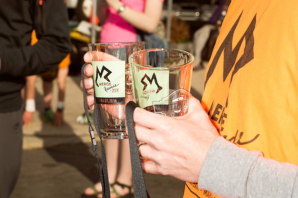March 22, 2014. Durham, North Carolina.<br />  Race finishers were given a commemorative pint glass and lanyard at the finish line.<br />   To celebrate their upcoming 25th anniversary, MERGE Records hosted a 25k race from Chapel Hill, where the label originated, to their new home in Durham. 693 people race the 15 mile course and celebrated at the after party in the streets.