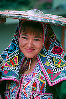 Peruvian woman in native costume, Machu Picchu archaeological site, Peru