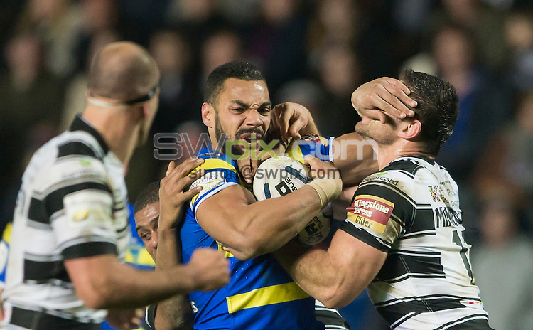 Picture by Allan McKenzie/SWpix.com - 13/02/2015 - Rugby League - First Utility Super League - Hull FC v Warrington Wolves - KC Stadium, Kingston upon Hull, England - Warrington's Ryan Atkins fends off Hull FC's Mark Minichiello.