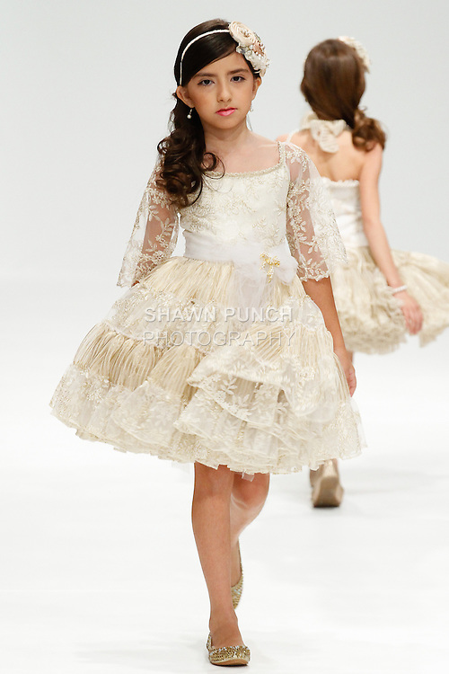 Child model walks runway in an outfit Wanda Beauchamp Girls Couture collection, during the Fashion Gallery New York Fashion Week Fall 2014, during New York Fashion Week Fall 2014, on February 8, 2014.