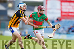 Donal Hunt Crotta O'Neills in action against Abbeydorney/Tralee Parnells Tadhg Brick in the Minor Hurling County Final   at Austin Stack Park on Sunday.