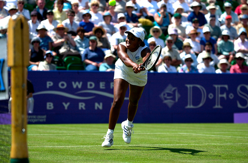 Photo. Rene Solari..22/6/01  .Eastbourne Day 5 (Semi-Finals).   Chanda Rubin puts up a good effort with this brilliant volley but loses out to Lindsay Davenport...