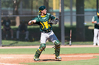 Oakland Athletics catcher Cesare Astorri (12) throws to second base during an Instructional League game against the Los Angeles Dodgers at Camelback Ranch on September 27, 2018 in Glendale, Arizona. (Zachary Lucy/Four Seam Images)