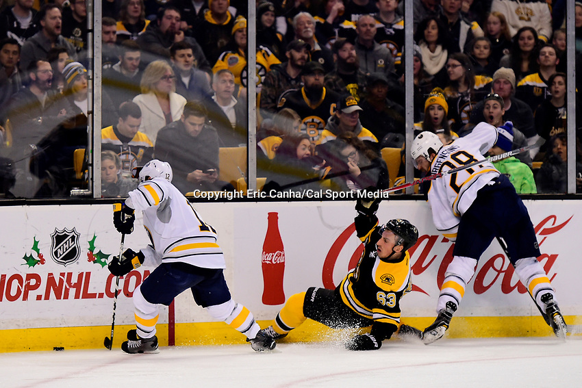 Saturday, December 31, 2016: Boston Bruins left wing Brad Marchand (63) gets knocked down by Buffalo Sabres center Zemgus Girgensons (28) during the National Hockey League game between the Buffalo Sabres and the Boston Bruins held at TD Garden, in Boston, Mass. Boston defeats Buffalo 3-1.  Eric Canha/CSM