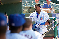 South Bend Cubs left fielder Eloy Jimenez (27) fist bumps teammates after hitting a home run during the second game of a doubleheader against the Peoria Chiefs on July 25, 2016 at Four Winds Field in South Bend, Indiana.  South Bend defeated Peoria 9-2.  (Mike Janes/Four Seam Images)