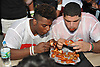 Jahmek Murphy of Tottenville High School, left, and Richie Bermudez of John F. Kennedy (Bronx) partcipate in a chicken wing eating contest featuring the senior football all-stars from New York City against their Long Island counterparts at Hofstra University on Saturday, June 18, 2016. The teams will face each other on the gridiron in the 21st annual Empire Challenge at Hofstra on Tuesday, June 21.
