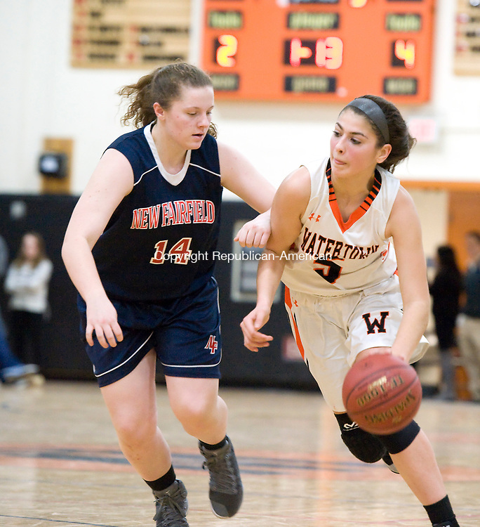WATERTOWN, CT-011118JS09---Watertown's Jordyn Forte (5) drives past New Fairfield's Grace Ware (14) during their non-league game Thursday at Watertown High School.<br />  Jim Shannon Republican-American