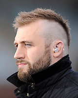 Joe Marler prepares to comment on the match for BT Sport