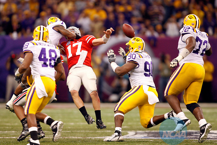 07 JAN 2008:  Linebacker Ali Highsmith (7) of Louisiana State University forces a fumble against quarterback Todd Boeckman (17) of Ohio State University during the BCS National Championship held at the Superdome in New Orleans, LA.  LSU defeated Ohio State 38-24 for the national title.  Jamie Schwaberow/NCAA Photos