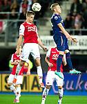 Nederland, Alkmaar, 20 oktober  2012.Eredivisie.Seizoen 2012-2013.AZ-N.E.C..Mikhail Rosheuvel van AZ .in duel om de bal met Soren Rieks van N.E.C.