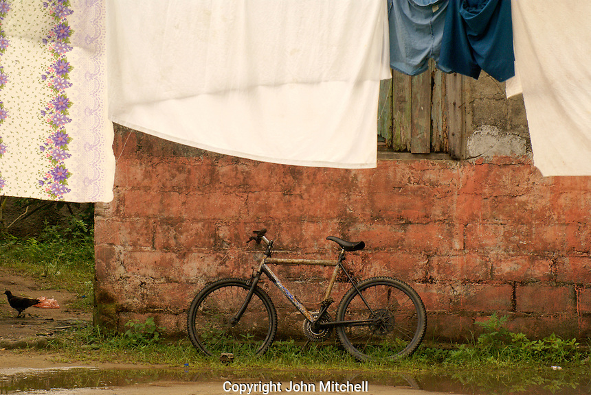 Bicycle and clothes hanging on a laundry line in the Garifuna village of Triunfo de la Cruz, Honduras....
