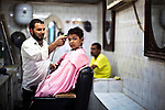 Tripoli - Libya - 11 October 2013 -- A young boy receives a haircut in a barber shop in Tripoli, a few days before the annual Muslim holiday of Eid. -- PHOTO: Iason ATHANASIADIS /  EUP-IMAGES