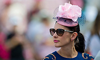 LOUISVILLE, KY - MAY 04: A woman wears a flowered pink fascinator on Kentucky Oaks Day at Churchill Downs on May 4, 2018 in Louisville, Kentucky. (Photo by Eric Patterson/Eclipse Sportswire/Getty Images)