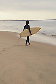 Stock photo of a teenage surfer at an Orange County California Beach