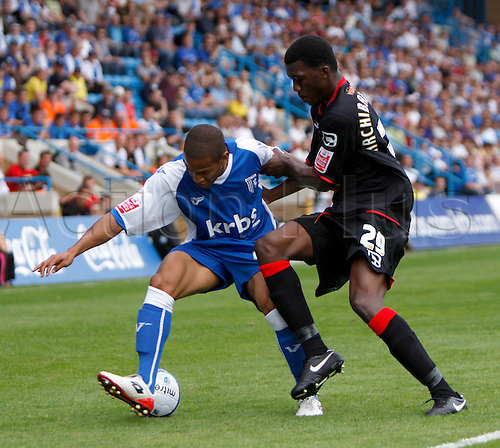 5th September 2009. Exeter City defender Troy Archibald-Henville (29) marshalls Simeon Jackson during the first half. Division 1 match - Gillingham v Exeter City at Priestfield Stadium, Gillingham, Kent, England.Photo: Colin Read/Actionplus.