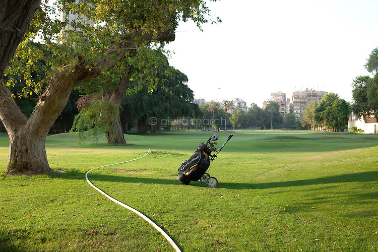 Egypt / Cairo / 29.7.2012 / A golf bag in the middle of the green. Cairo, Egypt. 2012.<br /> <br /> © Giulia Marchi