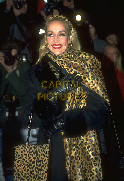 JERRY HALL.Ref: 4530.www.capitalpictures.com.sales@capitalpictures.com.© Capital Pictures.leopard print scarf, handbag, leather gloves.