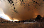 A wind-driven brush fire burns through Pleasant Valley, south of Reno, Nev., on Thursday, Jan. 19, 2012. (AP Photo/Cathleen Allison)