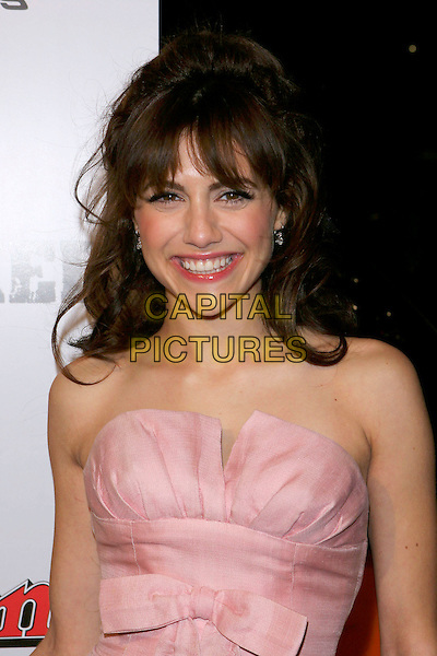 "BRITTANY MURPHY.""Sin City"" World Premiere held at Mann National Theater, Westwood, Los Angeles, California, USA, .March 28th 2005..half length pink strapless dress bow brunette fringe hair smiling.Ref: ADM.www.capitalpictures.com.sales@capitalpictures.com.©Jacqui Wong/AdMedia/Capital Pictures."