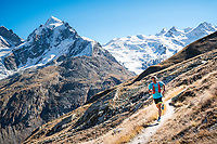 Trail running above the Rosegtal with Piz Roseg in the background. Pontresina, Switzerland