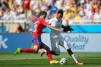 Daniel Sturridge of England and Giancarlo Gonzalez of Costa Rica