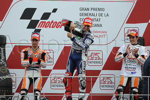 10.11.2013. Jorge Lorenzo (Yamaha Factory Racing) Dani Pedrosa (Repsol Honda Team) Marc Marquez (repsol Honda team) on the podium at Ricardo Tormo circuit in Valencia