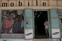Mobile advertising, Kampala road. Radios and torches are popular value-added features on phones for a predominately rural society with little streetlighting, and where a television may be shared by many. Advertising messages don't always depict this context.