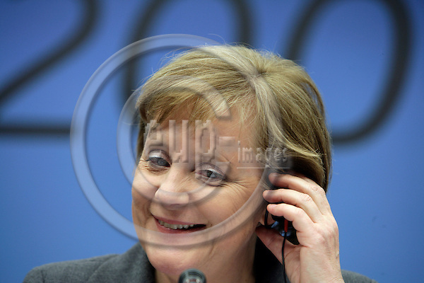 BRUSSELS - BELGIUM - 09 MARCH 2007 -- European Council Meeting -- Angela MERKEL, President and the German Federal Chancellor listening to a question at the final pressbriefing after the EU-Summit.    PHOTO: ERIK LUNTANG / EUP-Images