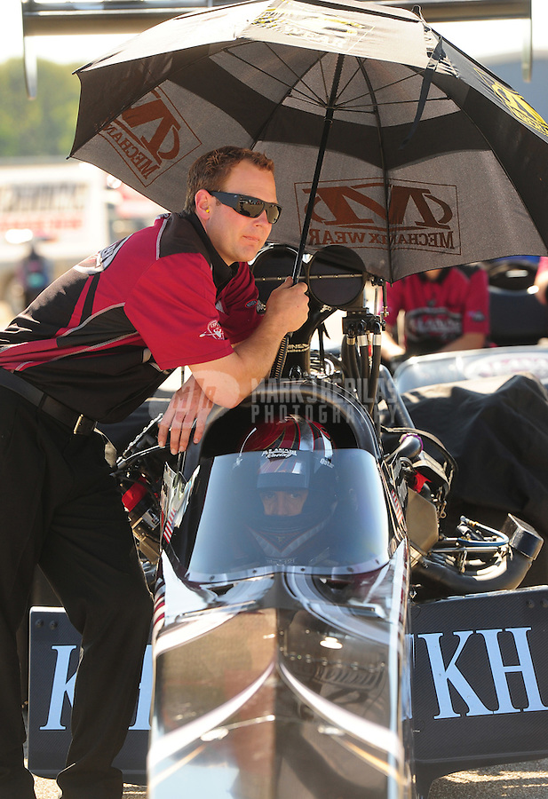 Sept. 23, 2011; Ennis, TX, USA: NHRA crew member for top fuel dragster driver Larry Dixon during qualifying for the Fall Nationals at the Texas Motorplex. Mandatory Credit: Mark J. Rebilas-